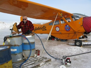 Refueling the Polar Pumpkin from drums, using my small Honda pump and system of hoses takes time.