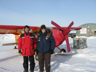 Dr. Dale Andersen and Art Mortvedt standing in front of the Polar Pumpkin at the Eureka Weather Station airport