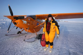 Art, in his yellow down polar flying suit, preparing to put the Tanis engine cover on the Polar Pumpkin shortly after an early morning 2 AM arrival at Ice Station Barneo - April 7, 2013 - approximately 20 miles from the Geographic North Pole.