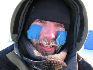 Audun Tholfsen with taped cheeks in preparation for the cold Arctic wind.
