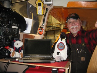 Left to Right:  Ted - the Teddy, Renee - the Penguin, and Art inside the cockpit of the Polar Pumpkin.  Ted and Renee are my honorary flight crew.