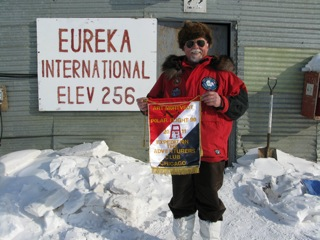 Art at the Eureka Weather Station with the fine hand made flag presented to Art by the Adventurers Club of Chicago.