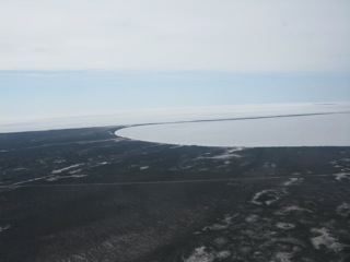 Looking south at the extreme northern end of Lake Winnipeg, one can only see water/ice on the horizon.