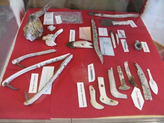 Inuit artifacts - harpoon heads, knife handles, etc. - in the Cambridge Bay visitor center.