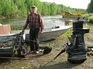 Lyman Vincent, homesteader from the Cosna River, fabricates one good outboard motor from the parts of three