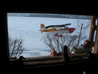 The Citabria aircraft on skis parked just outside our lodge window at Selby Lake